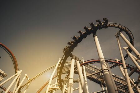 Silhouette of a rollercoaster in an amusement park.It reflects the investment that has fluctuations all the time.And high risk Banque d'images