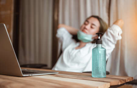 Woman work from home wearing mask protection wait for epidemic situation to improve soon at home. Coronavirus, covid-19, Work from home (WFH), Social distancing, Quarantine, Prevent infection concept.