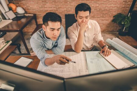 Team of engineer discussing of construction plan about the house plan the project for use in construction. Engineer, Engineering, Architecture, Design, Planning, Occupation concept.
