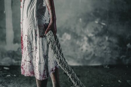 Horror ghost woman towing rope with resentment  torture and ask for help blood in hand, Halloween murder concept.