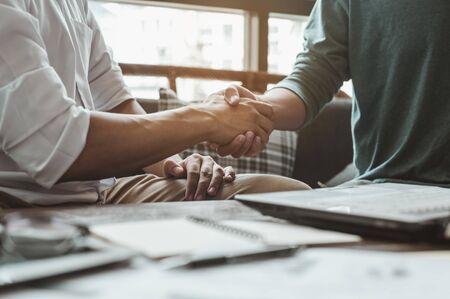 Handshake, meeting, greeting, teamwork, business, congratulate concepts. Commander handshaking new employee congratulating with starting a new job. Teamwork collaboration concept for business partners. Standard-Bild
