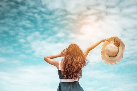Happy asian women with holding hat standing arms outstretched enjoy life on the beach vacation. beach, summer, liftstyle, positive mood, travel, relax concept. Standard-Bild