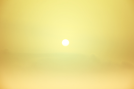 Blur background of flare light in the morning, Light yellow of sunrise in winter, Warm background of sun shine Imagens