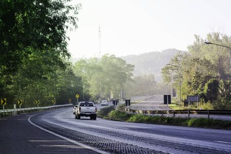 Beautiful green road in countryside, Landscape road with green forest, Main road on the mountain