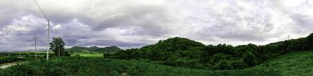 Landscape mountain with green nature, Energy be friendly with environment concept, Power distribution pylon system to rural community and countryside