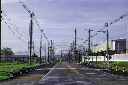 Transportation road with industrial factory building background Banco de Imagens