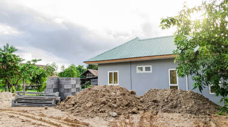 Concrete pole and bricks for home construction