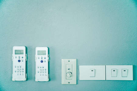 Electricity appliance remote control in home, Remote controller hang on the wall