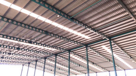 Roof steel beam structure in Industrial factory, Background of factory ceiling with one light blub, Abstract background
