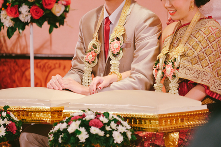 Groom and bride in traditional Thai wedding ceremony. Prepare for Hands pouring blessing water.
