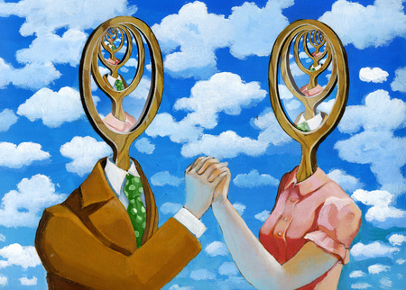 surreal: a man and a woman are reflected in each other and create the infinite as two mirrors placed opposite Stock Photo