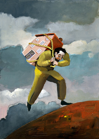 clandestine: a man who turns away from his country with difficulty carrying a house on his back Stock Photo
