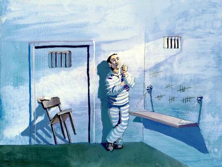 sociología: un prisionero bloquear la puerta de la celda con una silla de estar solo Foto de archivo