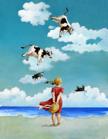 naivete: a view from behind girl on a beach looking out to sea and see the sky flying cows Stock Photo
