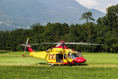 Alpine emergency helicopter rescue, Italy Stock Photo - 14147296