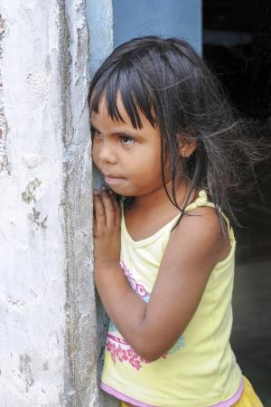 pb: Little girl in a suburb of a Brazilian city looking curious  JOAO PESSOA, PB - OCT 20  Unidentified little girl of the suburbs look curious on Oct 20, 2008 in Joao Pessoa, Brasil