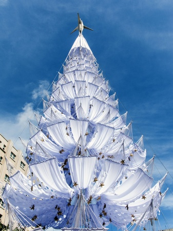 Beautiful Christmas tree in the summer of the tropics made with white hammocks photo