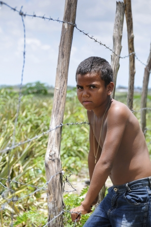 deprived: Joao Pessoa, PB - OCT 20: Angry boy in a poor suburbs of the city on Oct 20, 2008 in Joao Pessoa, Brazil. Editorial