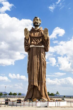 friar: Monument of Saint Francis in Caninde, Ceara State, Brazil. The statue is over 30 meters.