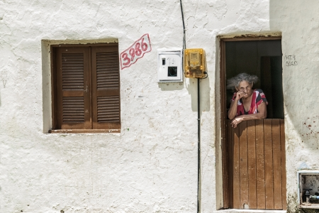 penury: Elderly woman on the front door  Community of the city center that will be expropriated and removed because of the World Cup 2014, Fortaleza, Brazil