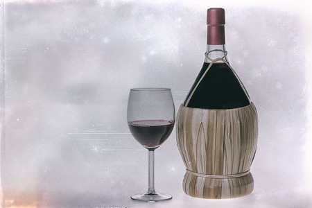 Chianti Bottle, fiasco, and glass of red wine photo