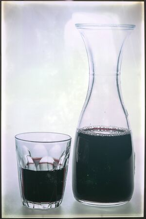 decanter: Vintage of decanter and glass of red wine