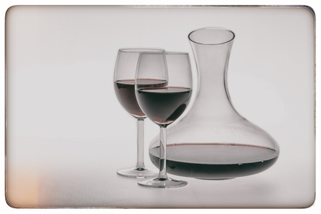 decanter: Vintage of decanter and two glasses of red wine