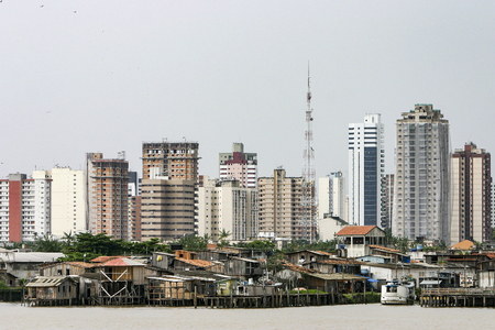 stilt: Belem: Modern buildings and stilt houses on the Guama river. Stark contrast to the social inequality between wealth and poverty Stock Photo