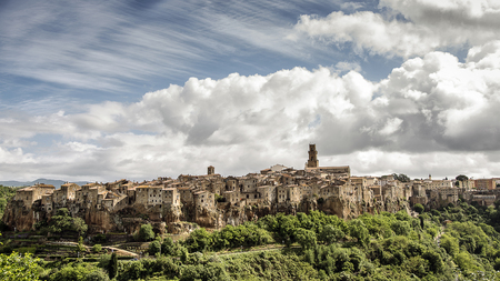 Panorama of Pitigliano, medieval village of Tuscany, province of Grosseto, on the rocky tuff hill. - Italy