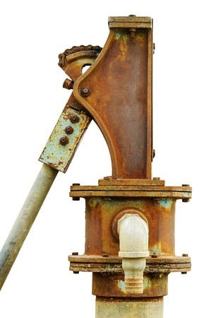 groundwater: Old aged rusty water pump isolated close up on white background