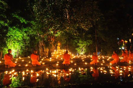 CHIANG MAI THAILAND - NOVEMBER 28  Group of monks sitting meditation in the sacred ritual at Wat Phan Tao temple in Loy Krathong and Yi Peng Festival on November 28, 2012 in Chiangmai,Thailand