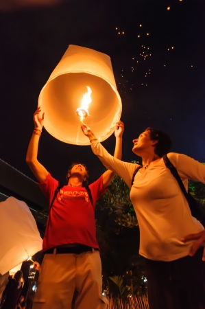 CHIANG MAI THAILAND-NOVEMBER 28   Tourist launching sky lantern in Loy Krathong and Yi Peng Festival on november 28, 2012 Chiangmai, Thailand