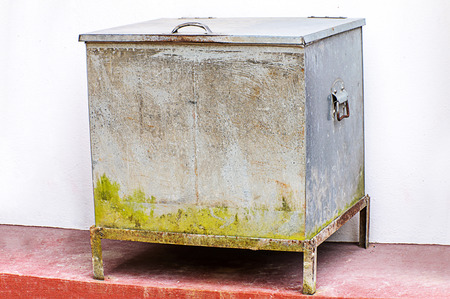 ice chest: Vintage ice chest at side white wall Stock Photo