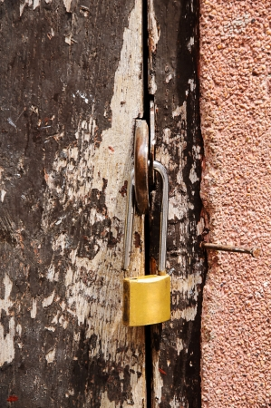 Padlock on a old wooden door  photo