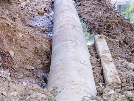 Placing construction a concrete drainage pipes photo