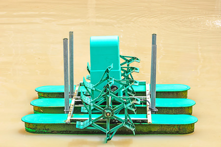 Green turbine water on pond photo