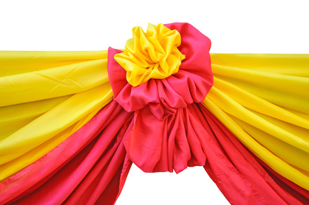 Red and yellow fabric ribbon for ceremony isolated on white  photo