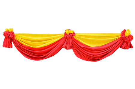 Red and yellow fabric ribbon for ceremony isolated on white with clipping path  photo
