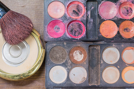 tangle: Used makeup accessories on tangle dirty table. Stock Photo