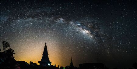 Milky Way Galaxy at Night above Pagoda silhouette in Thailand. photo