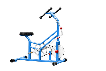 static bike: Exercise equipment isolated on white, work with path. Stock Photo