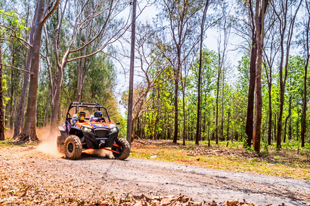 CHIANG MAI, THAILAND - MAY 03: Undefined Driver on Side-by-Side Vehicles UTV on countryside roads, May 03, 2015 in Chiang mai, Thailand.