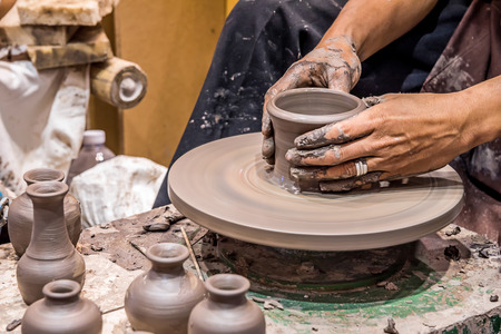 Hands working on pottery wheel, was produced on range of vase. 写真素材