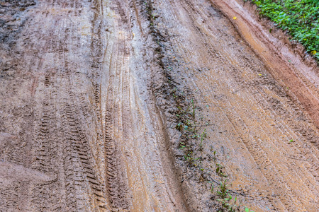 muddy tracks: Tire tracks on a muddy road in the countryside, Routing traffic in the countryside,