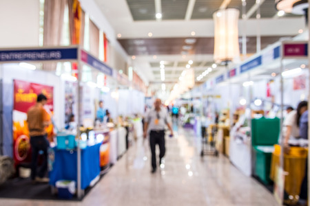 Abstract people walking in exhibition blurred defocusing background, Concept of business social gathering for meeting exchange. 写真素材