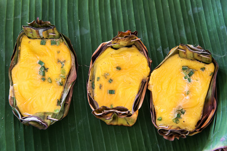 joist: Kai-Pam, Grilled seasoned Egg in joist banana leaves, thais traditional northern food. Stock Photo