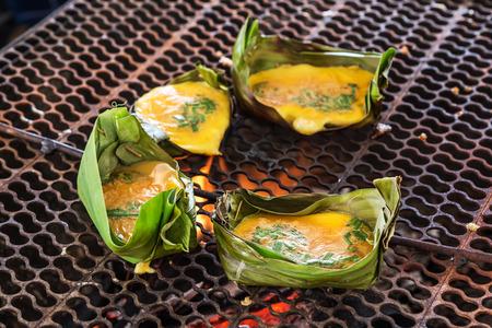 joist: Kai-Pam, Grilled seasoned Egg in joist banana leaves, thais traditional northern food. Stock Photo