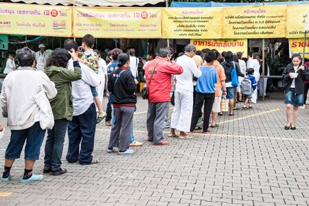 waited: CHIANG MAI, THAILAND - OCTOBER 13: People in queue waited to be taken vegetarian food during vegetarian food festival as following the traditional Chinese calendar, October 13, 2015 in Chiang mai, Thailand. Editorial
