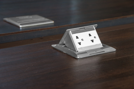 electric outlet: Electric outlet on wooden floor. Interior design detail power outlet. Stock Photo