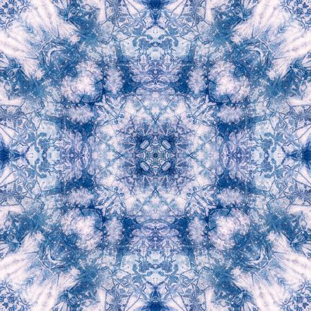 布染めネクタイ、万華鏡のパターン、壁紙の無限のパターンから作られた抽象的な背景パターン。 写真素材